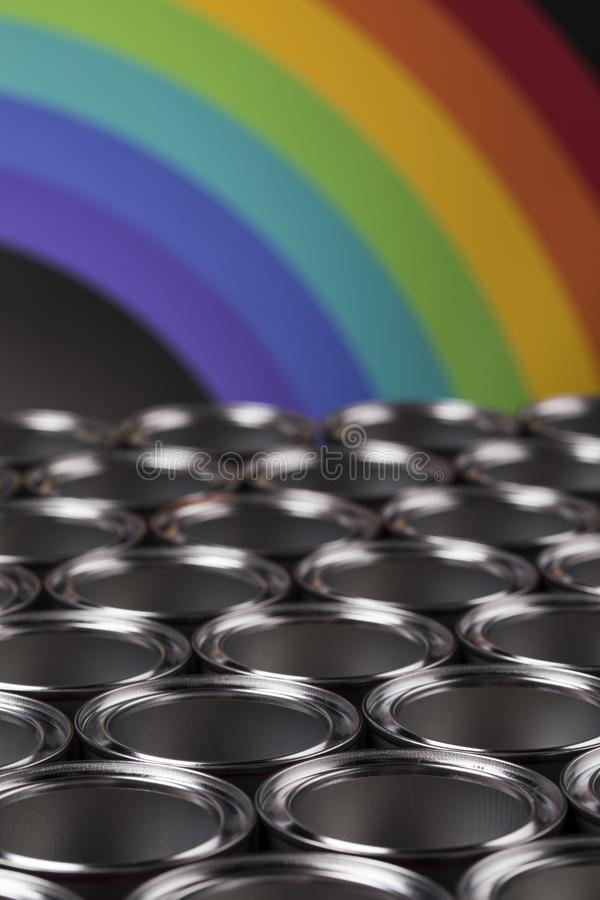 Rainbow, tin metal cans with color paint royalty free stock photography