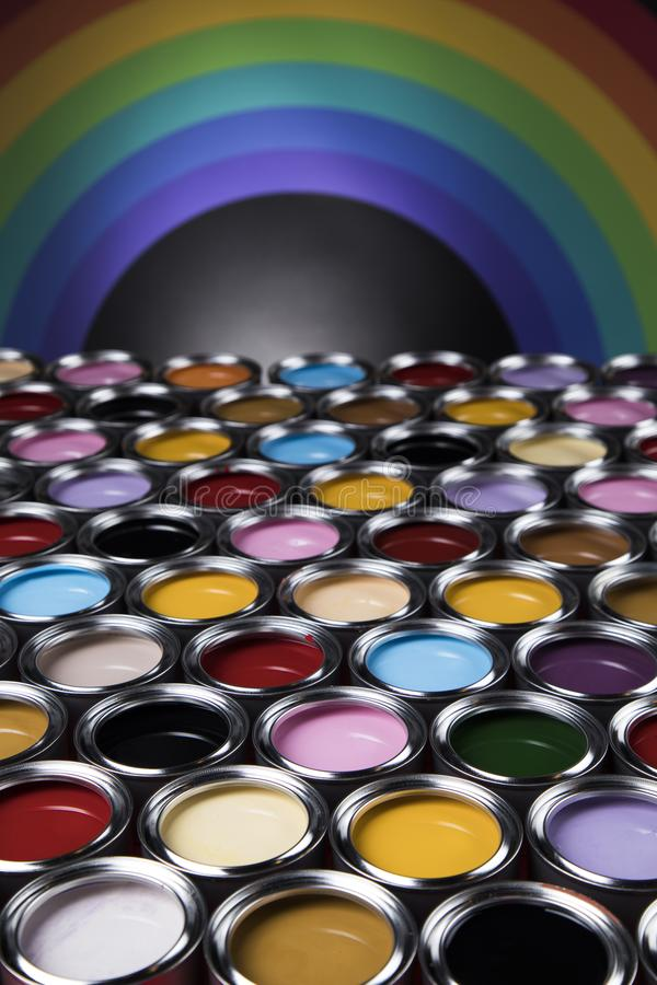Rainbow, tin metal cans with color paint stock images