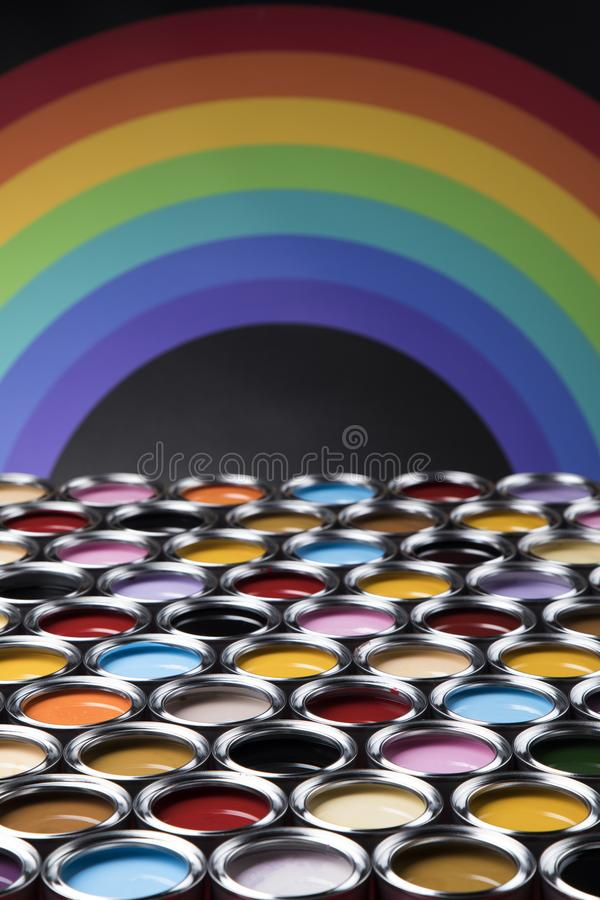 Rainbow, tin metal cans with color paint stock image