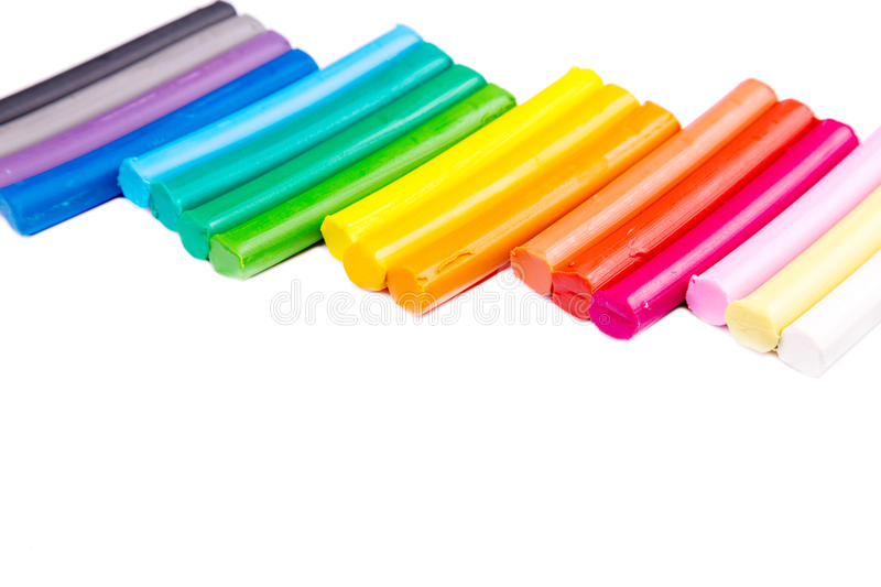 Rainbow colors plasticine bars, modeling clay. Isolated over white with copyspace for your sample text royalty free stock photo