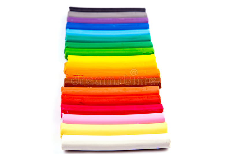 Rainbow colors plasticine bars, modeling clay. Isolated over white with copyspace for your sample text royalty free stock image