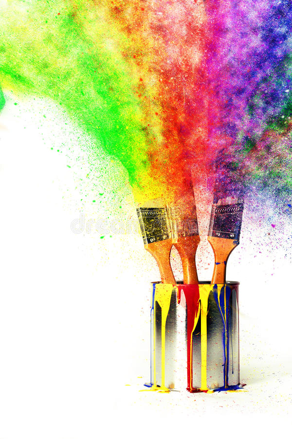 Rainbow of Colors from Primary Colors. Three paint bushes in paint can dripping with the primary colors of yellow, red, and blue with explosion of color made