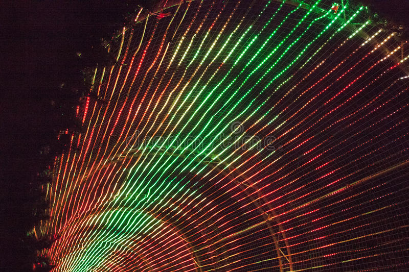 Rainbow of coloured lights in an arch stock images