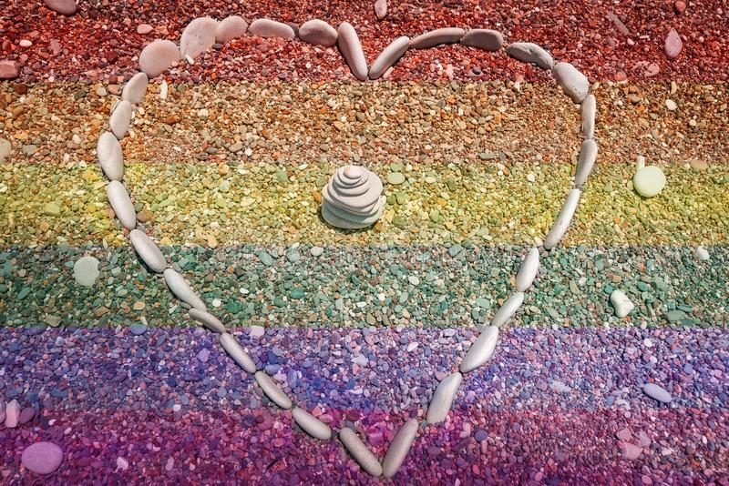 Rainbow colours heart shape stones stock photos