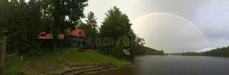 Cottage rainbow stock photo