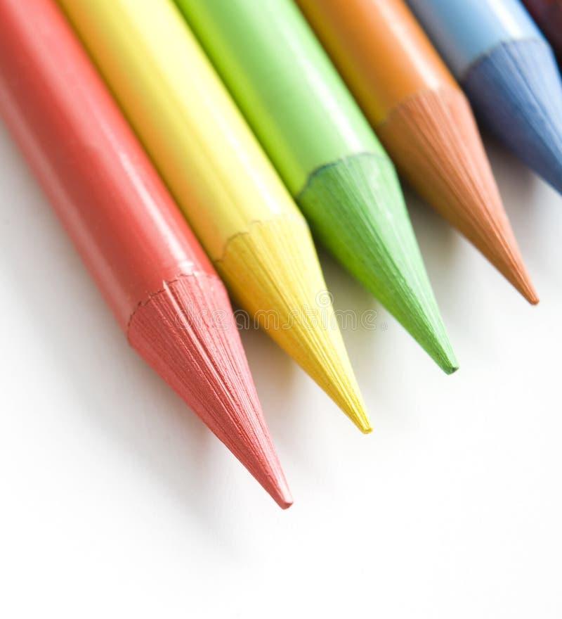 Rainbow crayons stock photos