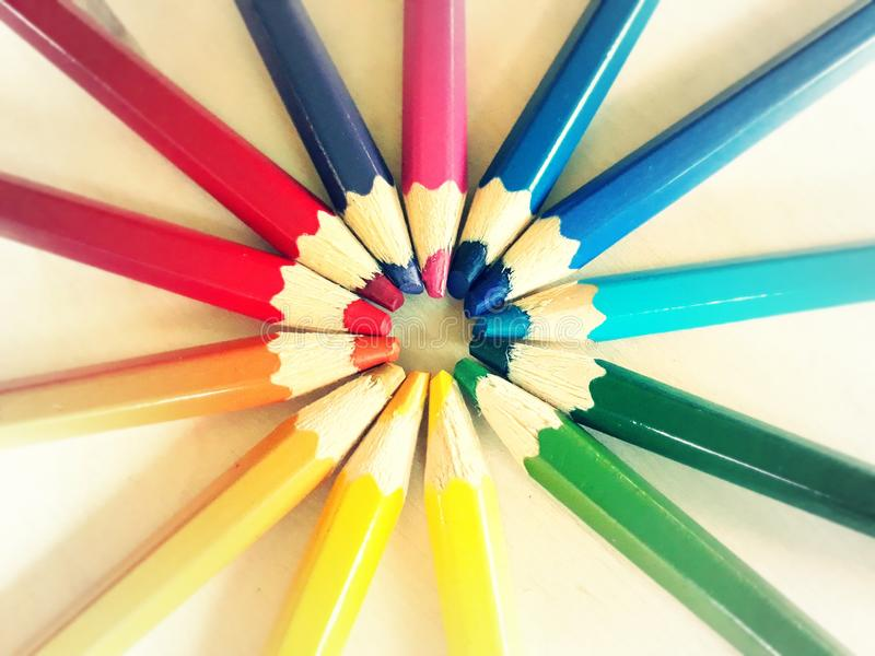 Rainbow crayons round light royalty free stock photography