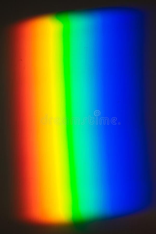 Rainbow created with prism, light projected on the wall royalty free stock photo