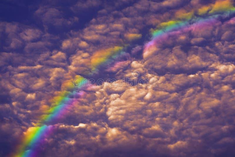 rainbow curve on sunset sky and orange cloud royalty free stock image