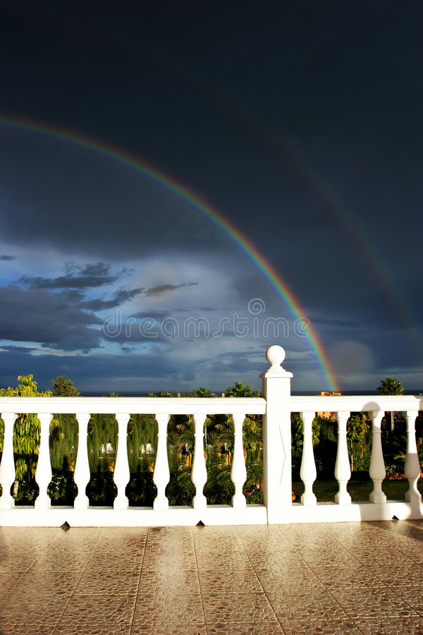 Download Rainbow and dark sky stock image. Image of color, dramatic - 170879