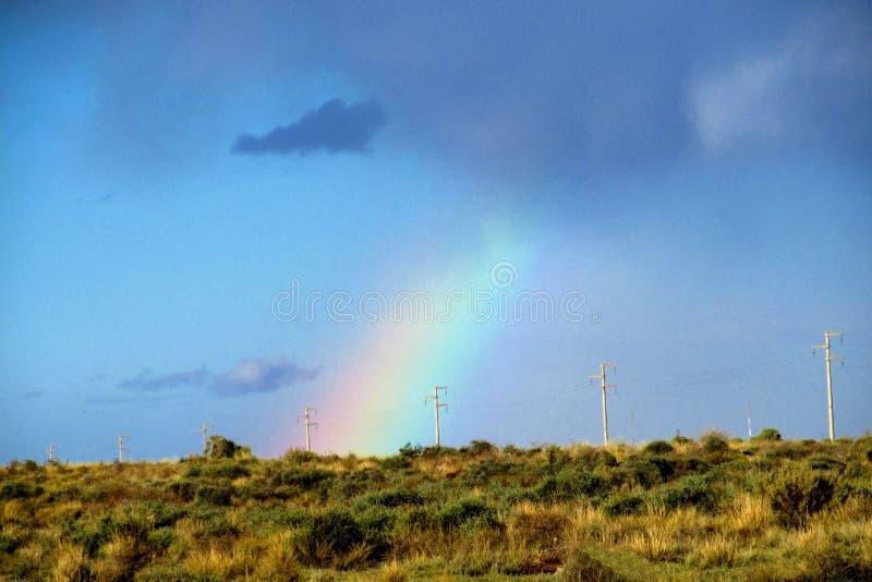 Rainbow on the dark sky royalty free stock images