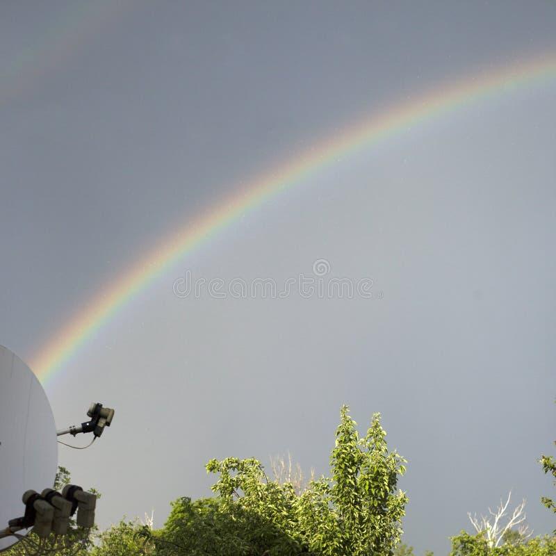 Rainbow in the dark sky after the rain royalty free stock photos