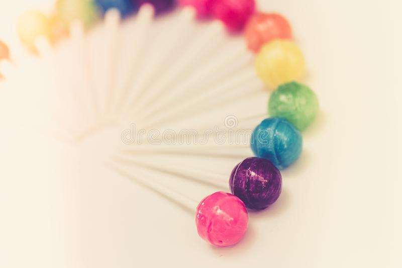 Rainbow design of sweet colorful lollipops stock images