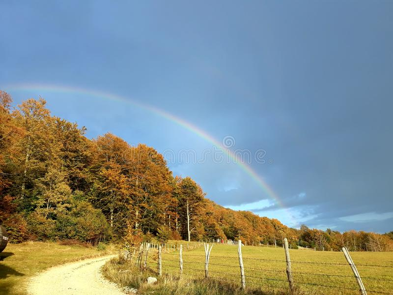 Rainbow after downpour royalty free stock photo