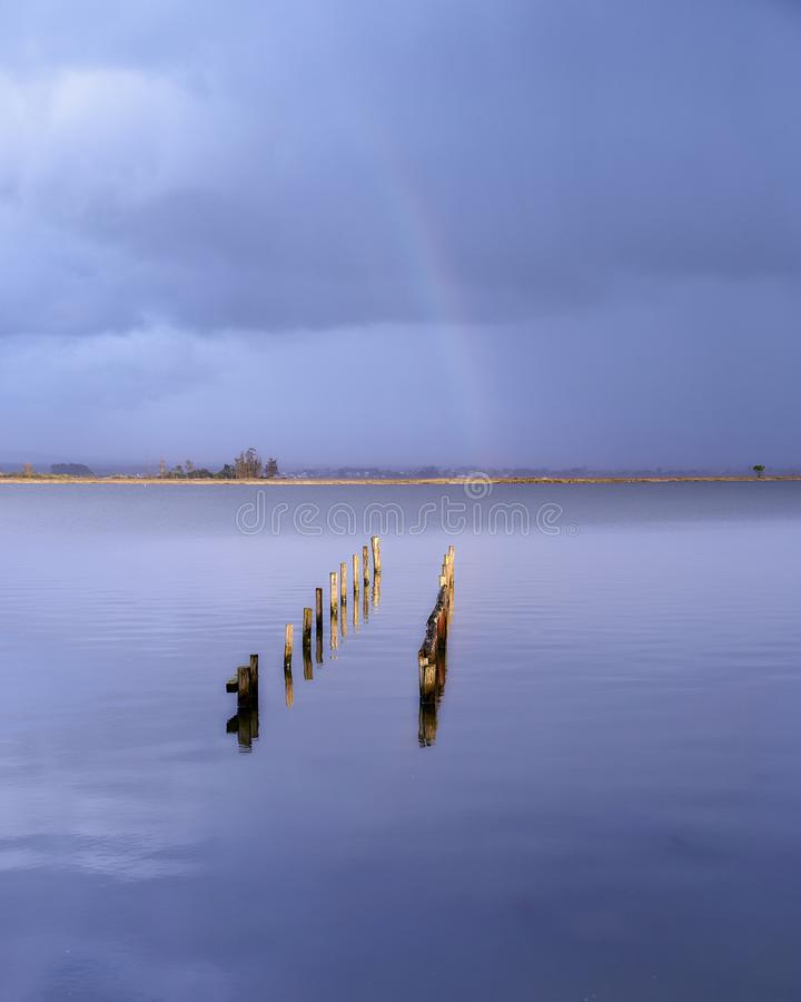 Rainbow at the end oft the lake stock photo