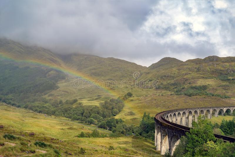 Famous Glenfinnan Railway Viaduct in Scotland and a rainbow stock image