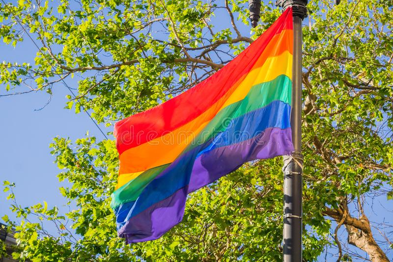 Rainbow flag blowing in the wind, LGBTQ pride month, San Francisco, California stock photography