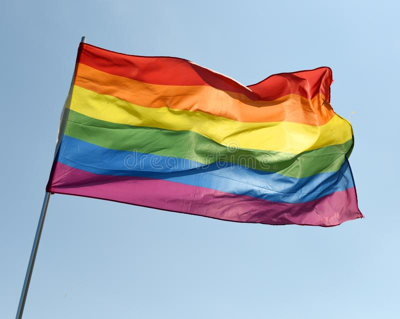 Rainbow flag on blue sky royalty free stock photos
