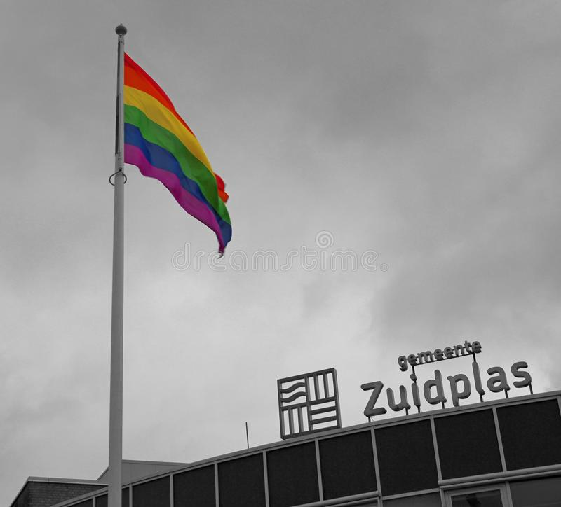 Rainbow flag high in the mast in the municipality of Zuidplas stock image