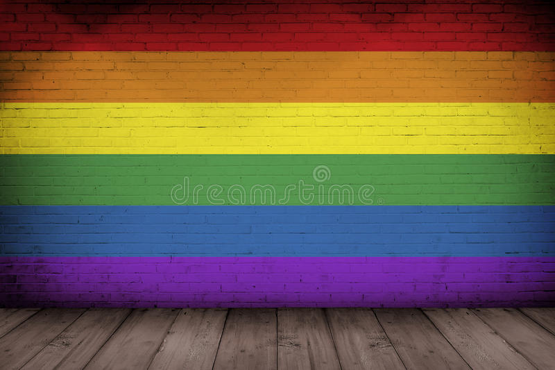 Rainbow flag painted on old brick wall royalty free stock photo