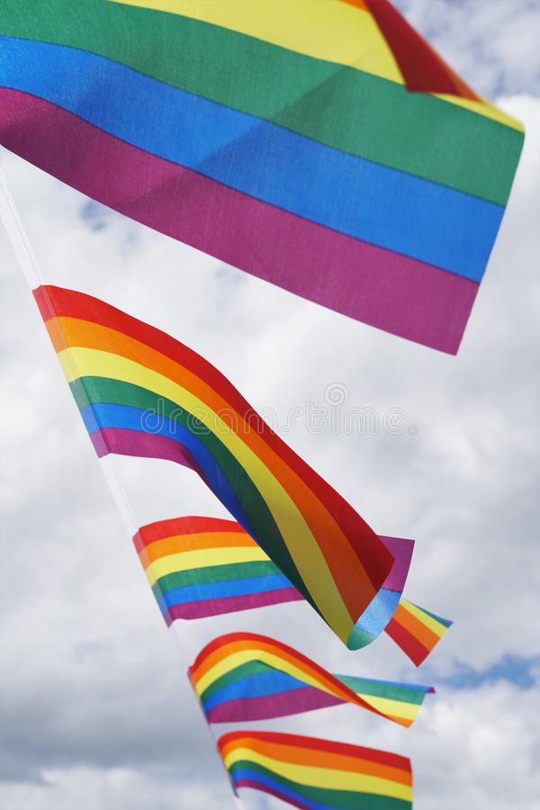 Rainbow flags at gay pride event stock images