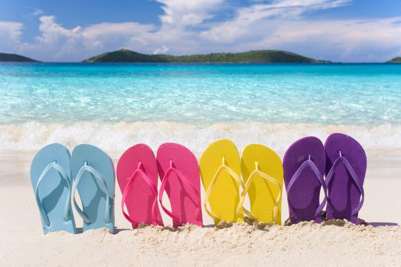 Rainbow flip flops beach stock image