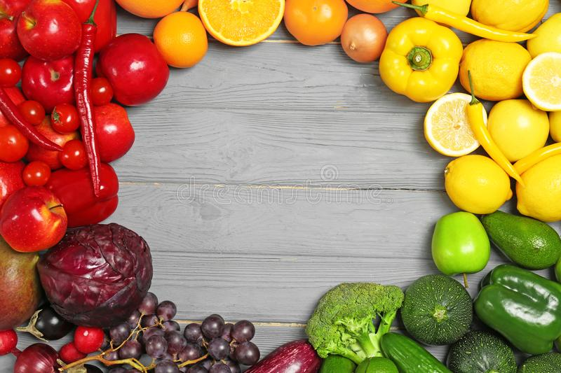 Rainbow frame made of fresh fruits and vegetables stock photo