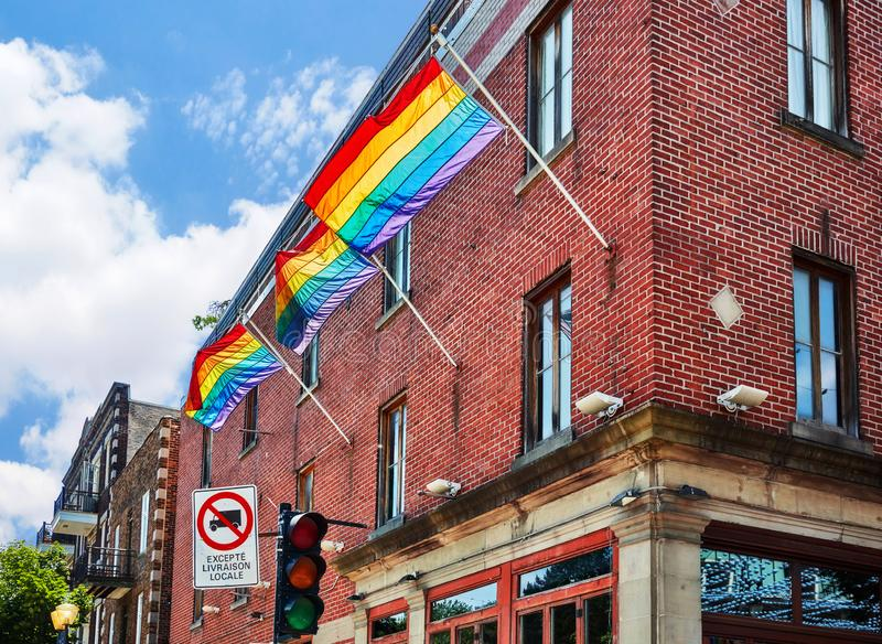 Rainbow gay pride flags waving on the flag pole royalty free stock images