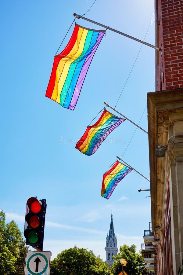 Rainbow gay pride flags waving on the flag pole stock photos