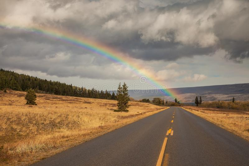 Rainbow and the Going to the Sun Road in Glacier National Park stock image