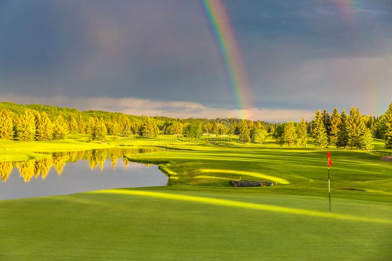 Rainbow on the golf course royalty free stock images