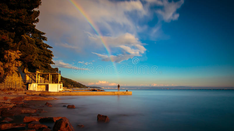 Rainbow in the gulf of Trieste. A spring storm with a colorful rainbow in the gulf of Trieste royalty free stock photo