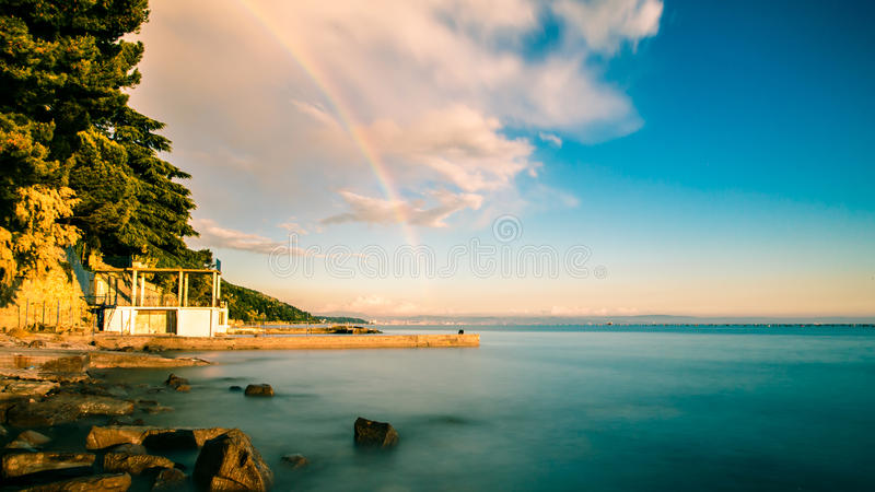 Rainbow in the gulf of Trieste. A spring storm with a colorful rainbow in the gulf of Trieste royalty free stock image