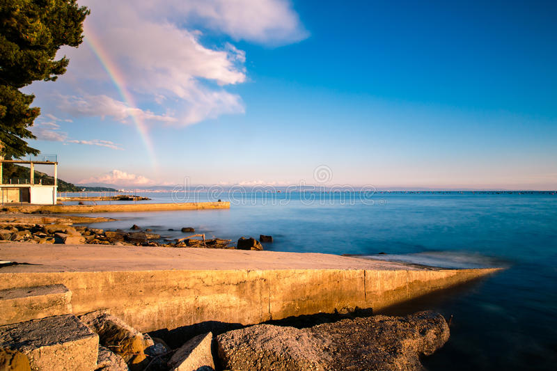 Rainbow in the gulf of Trieste. A spring storm with a colorful rainbow in the gulf of Trieste royalty free stock photos