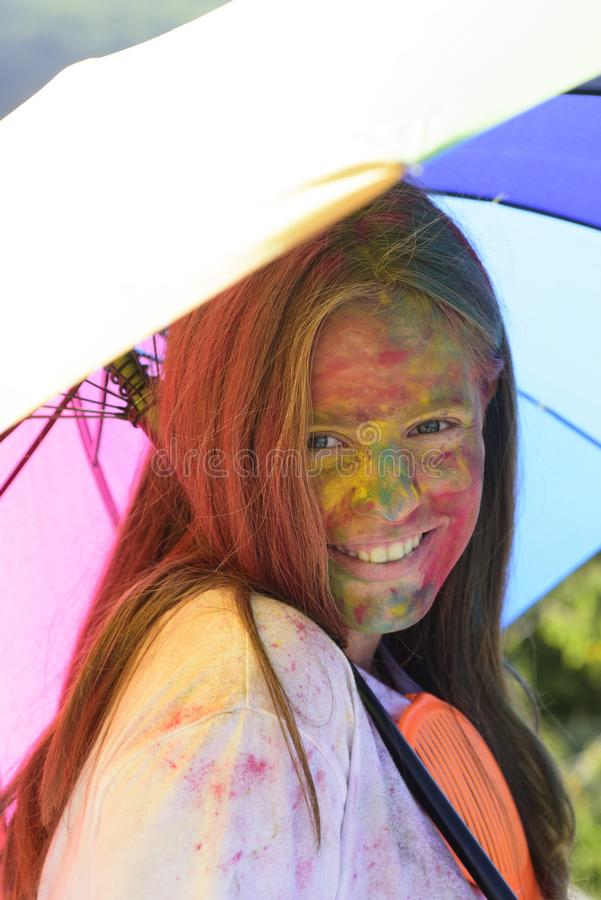 Rainbow Hairstyles. positive cheerful. child with creative body art. colorful paint makeup. Happy youth party. Optimist royalty free stock images