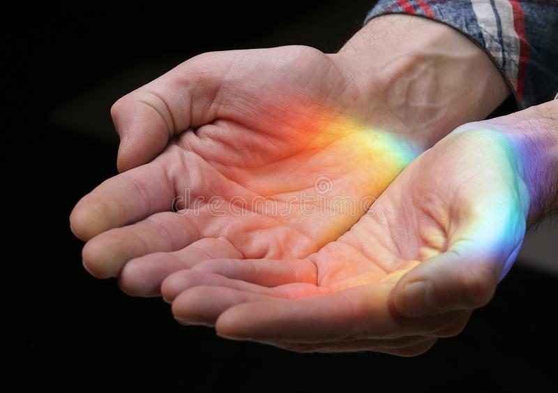 Rainbow in the hands royalty free stock photography