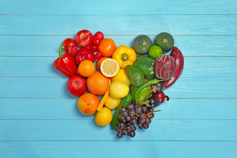 Rainbow heart made of fruits and vegetables royalty free stock images