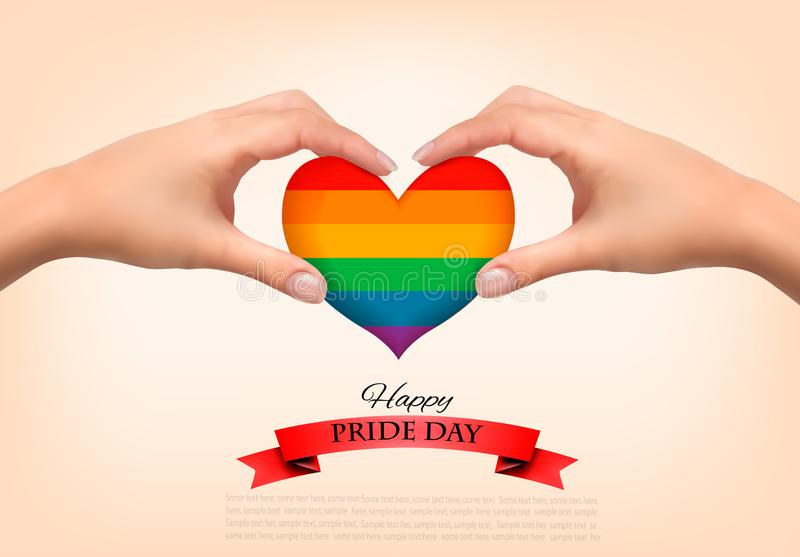 Rainbow heart shaped in hands. Gay pride concept. stock photo