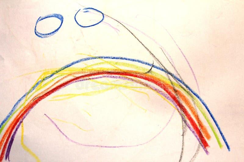 A rainbow on the kid`s drawing stock photos