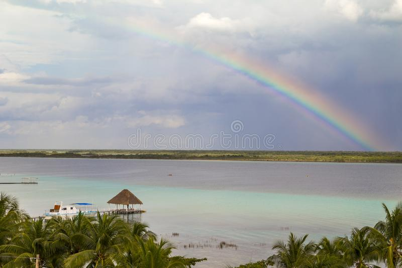 Rainbow Laguna de Bacalar Lagoon pier in Quintana roo Mexico. Water, tropical, landscape, leisure, beach, america, nature, travel, vacation, relax, lake royalty free stock images