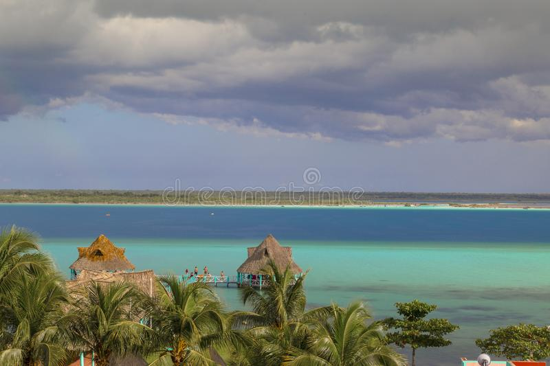 Rainbow Laguna de Bacalar Lagoon pier in Quintana roo Mexico. Water, tropical, landscape, leisure, beach, america, nature, travel, vacation, relax, lake stock images
