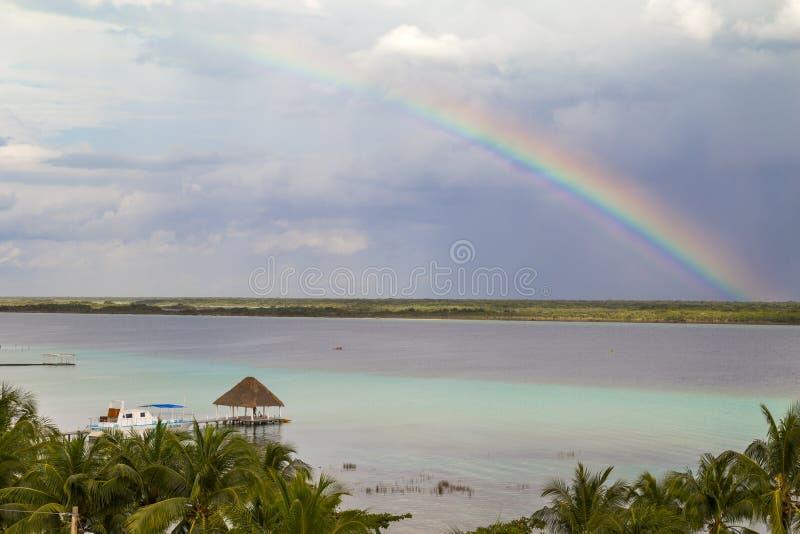 rainbow Laguna de Bacalar Lagoon pier w Quintana roo Meksyk obrazy royalty free