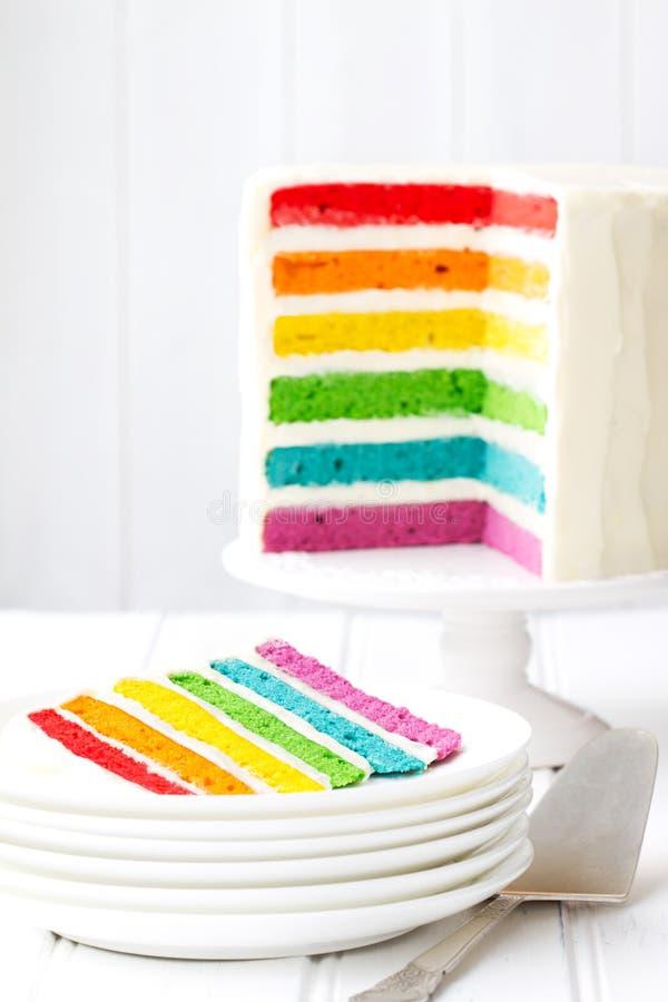 Rainbow layer cake. Brightly colored rainbow layer cake stock photo