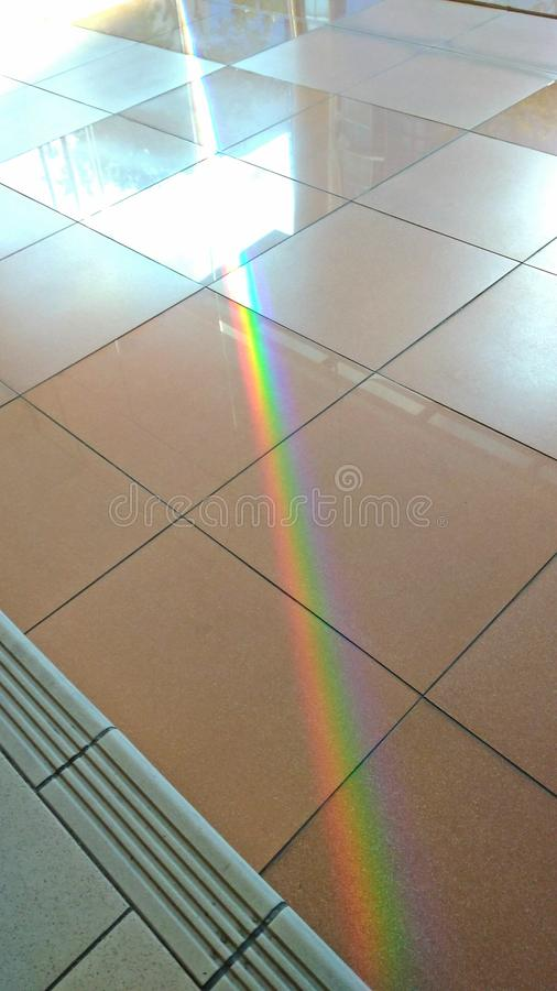 Rainbow light. Light from morning sun entering through glass door of building appears like rainbow colours royalty free stock photo