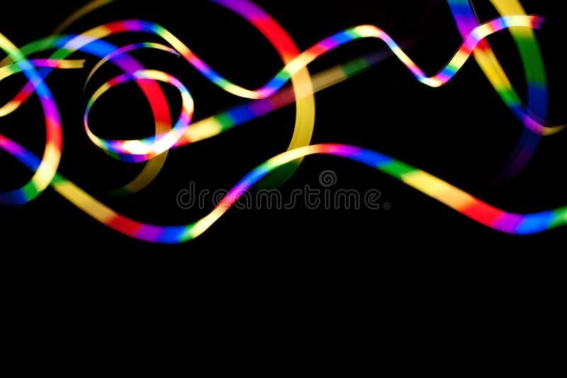 Rainbow Light Trails on Black royalty free illustration