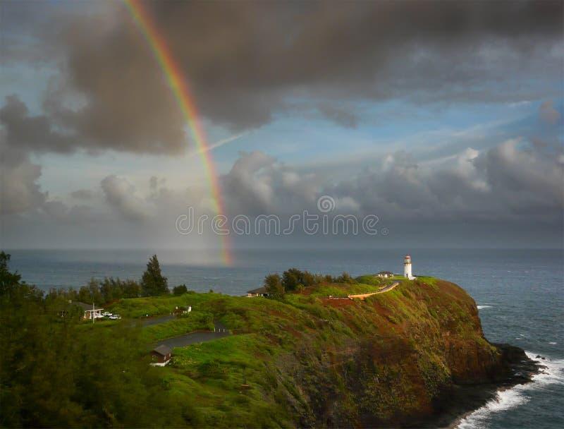 Rainbow and lighthouse. Rainbow over Kilauea Lighthouse at the North Shore of Kauai, Hawaii royalty free stock photos