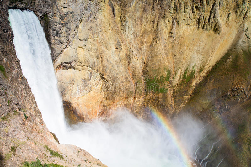 Rainbow at the Lower Falls of the Yellowstone river stock image