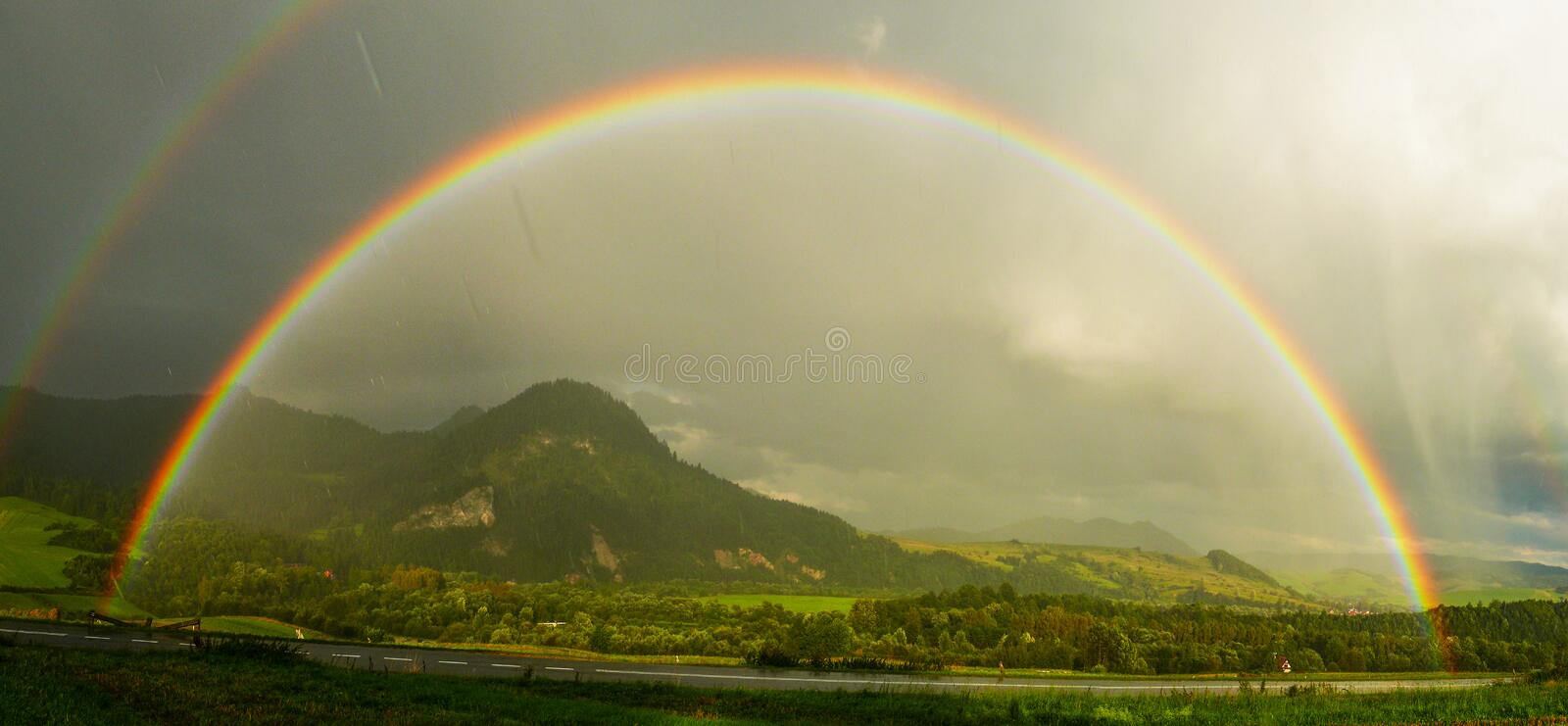 Double Rainbow. Rainbow makes bad weather a little bit better royalty free stock image