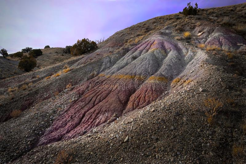 Rainbow Mountain in Utah, near Moab and Cleveland. Colorful Jurassic rock formation near Cleveland-Lloyd Dinosaur Quarry. Utah. United States stock photos