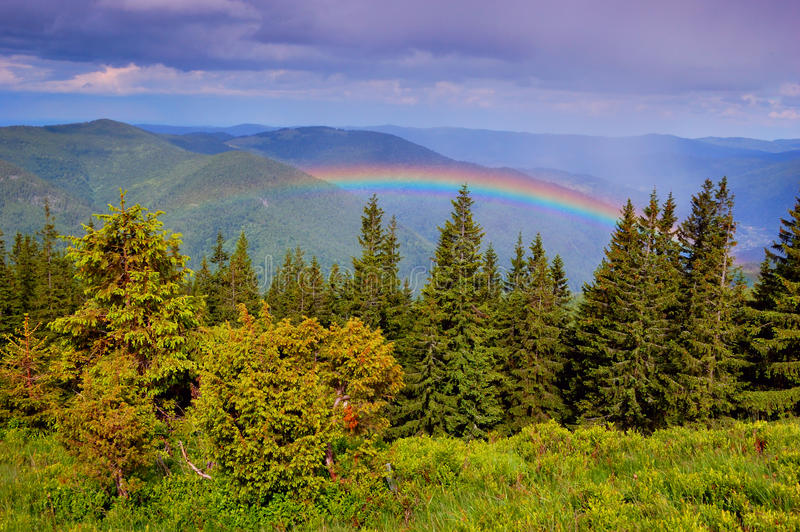 Rainbow in mountains. Rainbow after a rain in mountains Carpathians, Ukraine royalty free stock images
